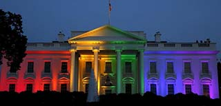 The Whitehouse with rainbow lighting